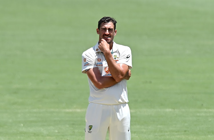 Mitchell Starc of Australia looks frustrated during day five of the 4th Test Match in the series between Australia and India at The Gabba on January 19, 2021 in Brisbane, Australia.