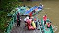 Longboats waiting to head upstream | photo © Kevin Dixon