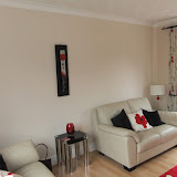 re-decoration of a living room in Maghull Merseyside - inc all walls etc and staining of door