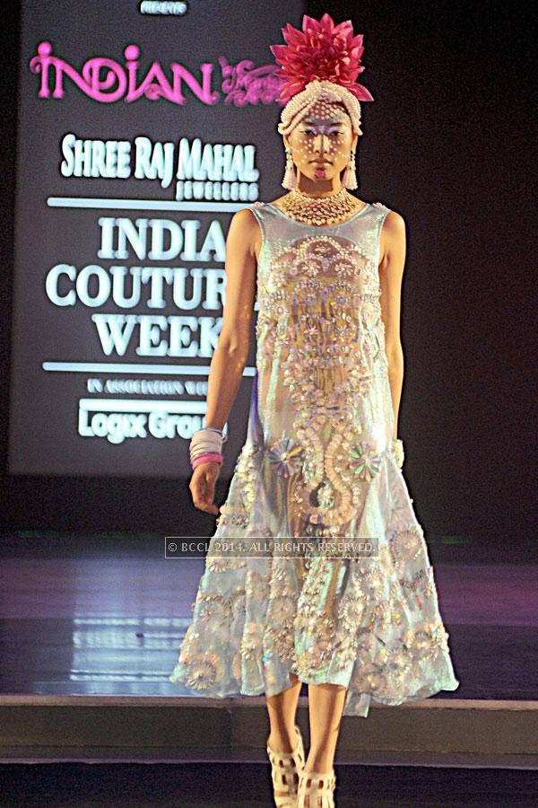 A model walks the ramp for designer Manish Arora on Day 3 of India Couture Week, 2014, held at Taj Palace hotel, New Delhi.