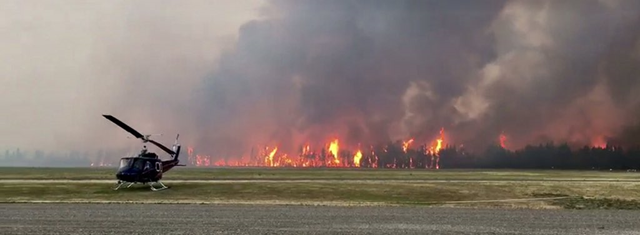 Forest fire burns near the Williams Lake airport, in British Columbia, 7 July 2017. Photo: Bryan Johns / Twitter