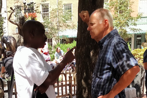 Eric had an animated conversation with a this man from Nigeria.