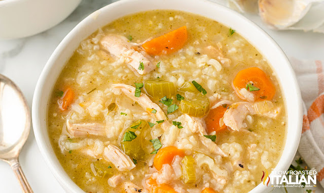 rice and turkey soup in a white bowl