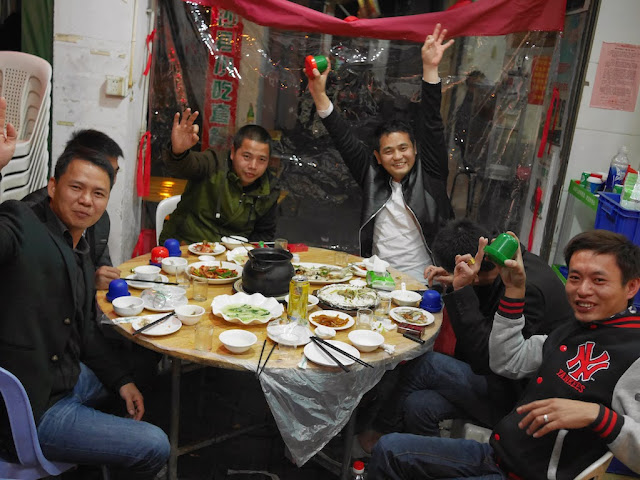six guys eating at seafood restaurant in Xiamen