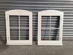 A pair of side hung flush casement windows with camber boards to match existing windows in a listed building