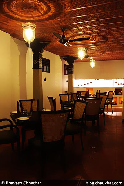 Seating area near the kitchen of Savya Rasa [Koregaon Park, Pune]