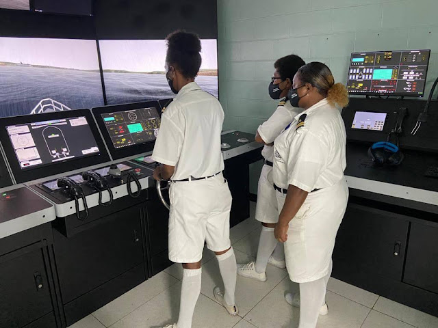 PNG young female cadets showing their navigating skills at the Maritime College in Madang