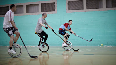 Regulars and team players of the LUNIs (London Unicycles) practise at the Queensbridge Sports Centre in Hackney, 3rd April 2012