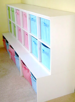 painted storage cubbies with beadboard back