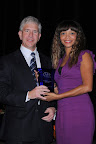 Gregg Engles, CEO, Dean Foods, named Outstanding Corporation, with Amy Tinsley, Constant Contact, sponsor of Outstanding Corporation Award