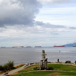 tanker and other cargo ships waiting in the Vancouver bay in Vancouver, British Columbia, Canada