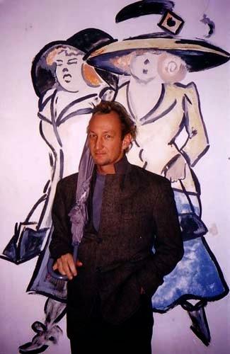 Robert the boulevardier in front of Berlin graffiti.