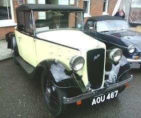 light yellow & black vintage motor car