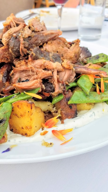Plate and Pitchfork, bringing farm to table dinners during the summer in Portland where guests dine al fresco on farms. Lamb Arista, cast iron fried red gold potatoes with romano beans and dill creme fraiche served with Brooks Wines 2014 Janus Pinot Noir