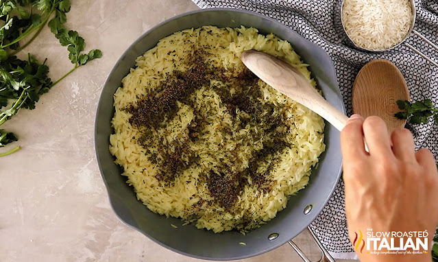 chicken rice side dish with parsley on top