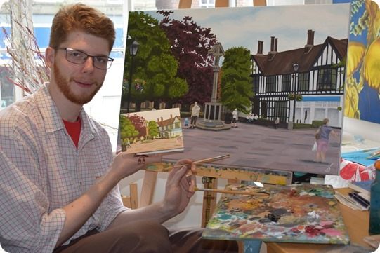 Christian Turner with his oil  painting and card of Nantwich Town Square
