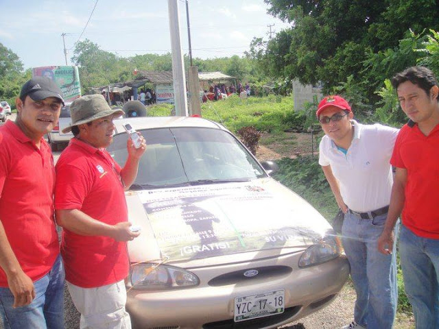The publicity team (Irving, Daniel, Jiovani, and Carlos) outfitted this car with speakers to invite the town to take part in the event.
