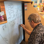 Author Timothy Young signs the wall!