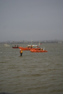 23 December 2012 - Poole and Swanage ILBs plus a crew member search the area.  Photo credit: Liam McKenna, Poole/RNLI