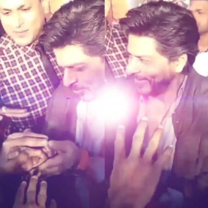 Shah Rukh Khan's reaction to the 'secret' gift from the paparazzi is the cutest thing on the internet today!