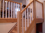 An Oak closed tread flight with softwood painted balusters