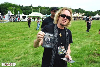 20160610-paris--Adrian is giving flyers in supporting his son's band during Download in France