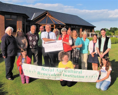 Seriously injured farmer repays charity that helped family
