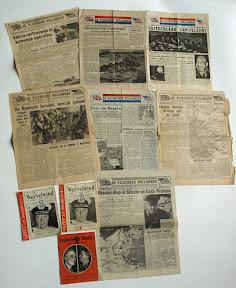 Vlugschriften gedropt boven bezet Nederland door de RAF. Vanwege de ligging aan de grens kwamen in Enschede zowel Nederlandstalige als duitstalige blaadjes neer.