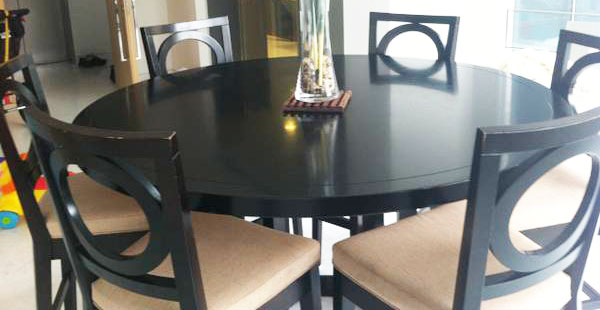 the third item is a dark colour round dining table with 6 chairs it