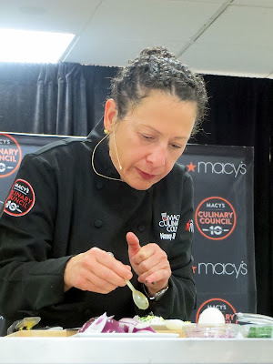Culinary Council Recap: Nancy Silverton, Culinary Council member at the Macy's at Washington Square Dec 14, 2013, preparing to plate her recipe for Burrata with Caviar