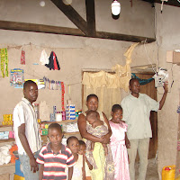 Evangelist Odilo and his family in Manantu, turning on the new solar light in the living room.