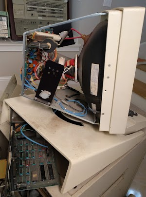 Inside the Xerox Alto's display. With the cover removed, the CRT and monitor circuitry are visible. The 7-wire interface board is at bottom-left. The Alto itself is in the cabinet under the display.