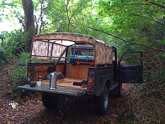 The Defender stopped in a small grove of trees, a footpath up to the fields to the right, a great spot to watch out for deer grazing in the fields.