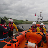 8 June 2012: The ILB alongside the grounded speedboat, with Dave Riley at the helm. Photo: RNLI/Mark Ponchaud