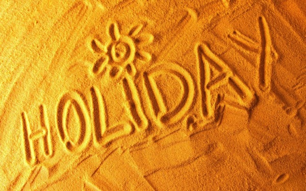 Holiday written in the sand!