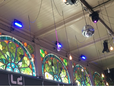 stained glass windows, disco ball on the ceiling and dangling lightbulbs