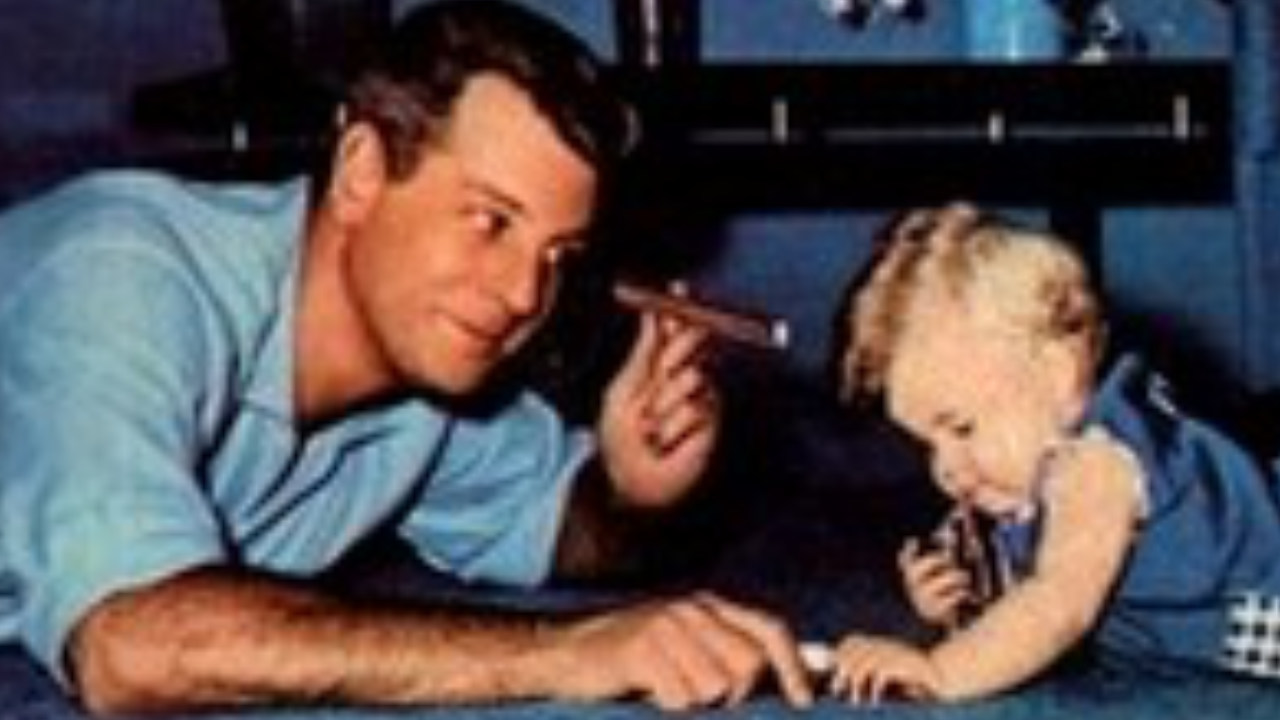 Campanha dos Cigarros Suerdieck onde apresentam um pai fumando ao lado de um bebê