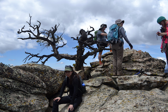 people clustered on a rock just over 7000 feet high