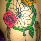roses feathers - tattoos ideas