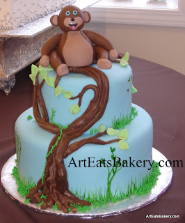Kid's unique creative birthday cake with tree and monkey