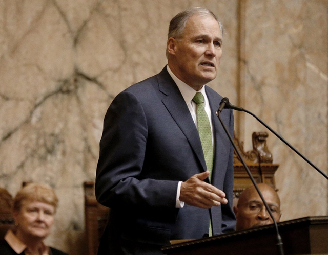 Washington Governor Jay Inslee, who is mulling a White House bid, highlighted his clean-energy agenda and many traditional Democratic positions in his State of the State address on 15 January 2019. Photo: Bettina Hansen / The Seattle Times