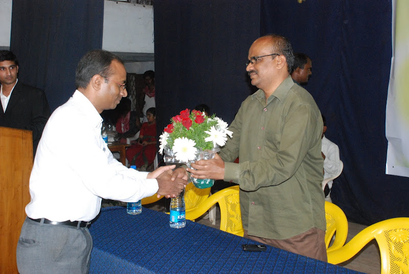 TeNA India coordinator Hari Krishna presenting bouquet to Mallepalli Laxmaih
