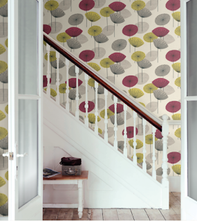 green and purple wallpaper on stairwell - dandelion clocks pattern