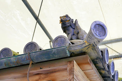 Seems like a natural position to me for a Guardian Lion - spotted on the roof of a gate on the grounds of Kinkakuji (Golden Pavilion) in Kyoto