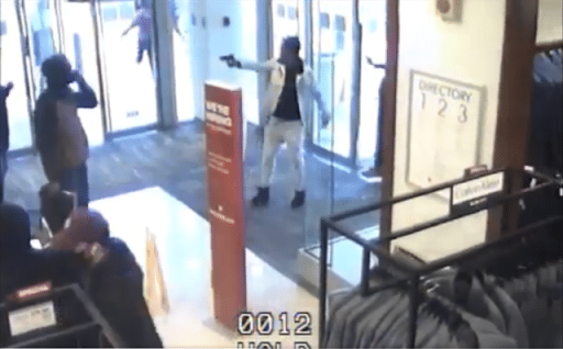 Georgia Macy's robbery shoplifter points gun at store's loss prevention agent during escape