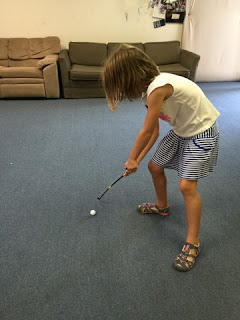 Student uses violin bow as golfing iron