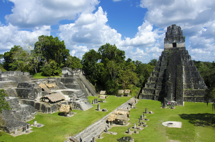 Tikal ruins: plazas, pyramids, palaces of hewn stone, soar 200ft clean out of the forest canopy