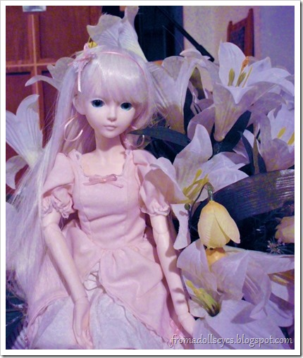 A ball jointed doll and lillies