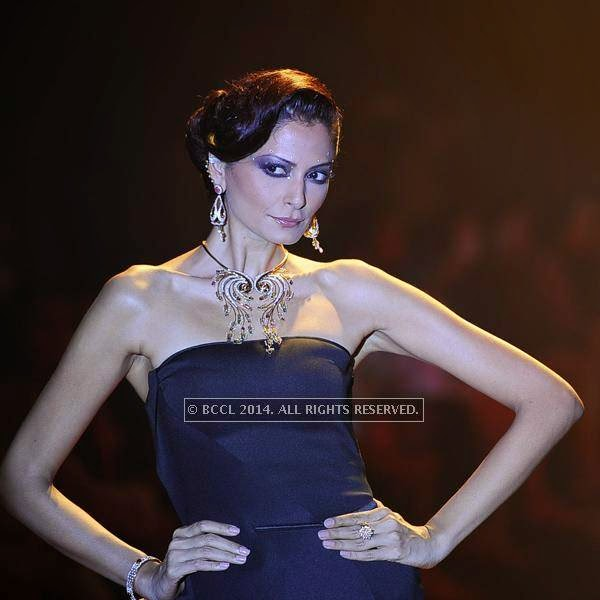 A model showcases a creation by Emerald on Day 3 of India International Jewellery Week (IIJW), 2014 at Grand Hyatt, Mumbai.