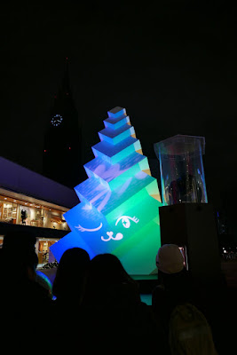 One of the displays at Shinjuku Terrace City Winter Illumination included a white Christmas tree like sculpture. Placing your hands on a globe, you can invoke different projections onto the sculpture with colors and animations